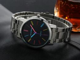 Encanto de la banda de reloj online-Banda de acero inoxidable reloj de las mujeres vestido de colores relojes marca señoras elegancia encantos del reloj relogio feminino lujo Ginebra reloj