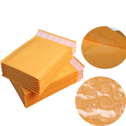 Wholesale Pad 11 - Wholesale-50pcs lot kraft bubble postal envelope poly mailer shipping Self-Seal mailing padded postage polymailer yellow bags 11*13cm