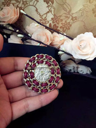Wholesale Asian Sweater Women - European and American fashion circle staggered high quality suit sweater hat joker woman C brooch