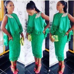 Vestidos de laço esmeralda on-line-Verde esmeralda áfrica vestidos de baile 2017 sem mangas lace bainha vestidos de noite estilo do cabo vestidos de festa árabe chá comprimento formal wear
