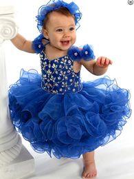 niedliche handgemachte blumen Rabatt Royal Blue Cute Ballkleider Mädchen Glitzer Pageant Kleider Perlen Kristalle Blumen Schöne Baby Erstkommunion mit handgefertigten Blumen Kind Kleid