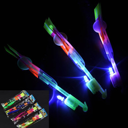 Wholesale Led Lighted Toy Helicopter - led Amazing flying Light Arrow Rocket Helicopter Flying Toy Party Fun Gift Elastic flshing gow up roket chirstmas toys led flying toys
