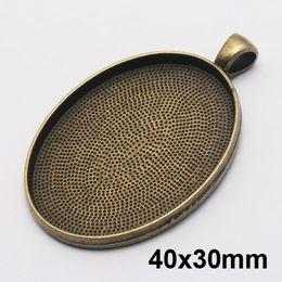 Bandejas pingente oval on-line-40x30mm oval diy bandejas de pingente de cabochão oval definir pingente de bronze bandeja configurações ovais pingente blanks