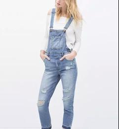 2019 nuevo diseño de moda de marca pantalón Las señoras de la nueva moda elegante agujero clásico azul pantalones de la liga del dril de algodón pantalones vaqueros trouses bolsos de diseño de marca delgado casual nuevo diseño de moda de marca pantalón baratos