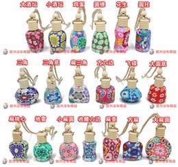Canada 15 ml Car hang décoration céramique essence huile parfum bouteille Hang corde vide bouteille couleurs aléatoires / styles D906 cheap 15ml perfume bottles Offre