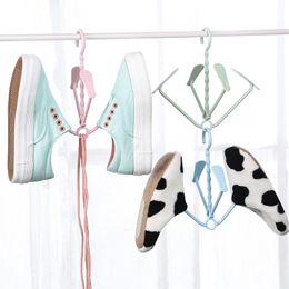 Sapato cremalheiras sapatos de dobramento fácil secagem cabide de cremalheira rosa, verde, azul 4 ganchos de plástico organizador de prateleira de suspensão lz0442 supplier folding shoe shelf de Fornecedores de prateleira de sapato dobrável