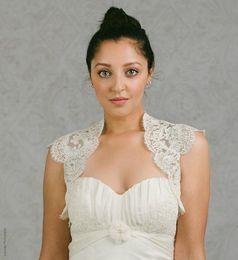Wholesale Wedding Dresses Lace Coats - 2018 Short Cheap Bridal Wraps Hollow Back Bridal Coat Lace Jackets Wedding Capes Wraps Bolero Jacket Wedding Dress Wraps Plus Size