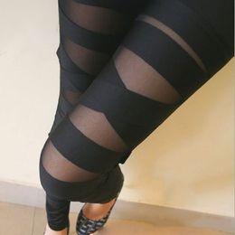 Leggings negros vendados online-Al por mayor-Mujeres Señoras Chicas Sexy Leggings Punk Color sólido Vendaje Malla Negro Leggings Pantalones
