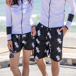 827d812487 Wholesale-2016 Fashion Black White Stars Surf Board Shorts Beach Swim Pants  Lovers Couple Models Men Women Girls Boys Swimwear Shorts A19 on sale