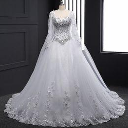 vestidos de novia únicos de invierno Rebajas 2019 cristales Rhinestones Bling vestido de novia de manga larga novia una línea de vestidos de novia con tren de Watteau