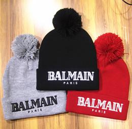 Grande stella di natale online-4 colori Cappelli invernali berretto a flangia hip hop popolare cappello lavorato a maglia cappello di lana cappello di lana stella modelli Natale berretti cappelli qualità A +++++