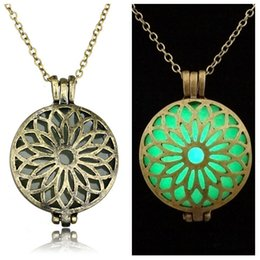 Wholesale Enamel Jewelry Box Blue - European and American fashion hot alloy hollow sunflowers luminous blue enamel necklace jewelry box can be opened with a photo pendant