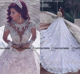 Erstaunliche hochzeitskleid luxus online-2019 Amazing Sparkly Crystal Perlen Spitze Langarm Brautkleider Royal Train Middle East Arabisch Luxus Ballkleid Brautkleid