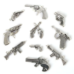 Wholesale Metal Plate Necklace Gold - Free shipping New Mix 35pcs lot Vintage Charms Gun Pendant Antique Silver Fit Bracelets Necklace DIY Metal Jewelry Findings jewelry making