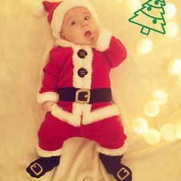 Trajes de santa claus para niños online-niño pequeño traje de navidad ropa 4 unids clásico trajes de santa claus ropa roja con gorras zapatos para niños recién nacidos niñas ropa de navidad