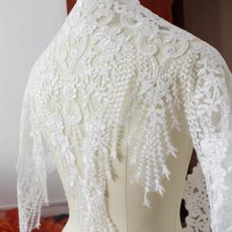 Venta por yarda 60 cm de ancho blanco bordado de velo de novia francés Recorte de encaje vestido de novia de encaje decoración de fiesta con lentejuelas de PVC desde fabricantes