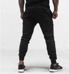 Wholesale Muscles Men Pants - 2017 New Muscle brother men Sports Jogging trousers Fitness bodybuilding training Casual Sweatpants Feet Cotton Solid Color Running Pants