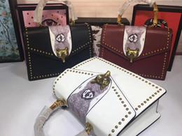nueva cabeza de zorro de piel de serpiente de cuero genuino famosa marca de bolsos de las mujeres bolsos de calidad superior tamaño mediano 31.5 * 22 * 11 cm desde fabricantes