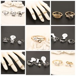 Wholesale Simple Flower Engagement Rings - The Korean version of the micro diamond studded gold silver flower ring finger joint ring zircon simple cheap