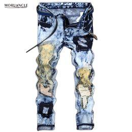 Calça jeans para homens on-line-Atacado- MORUANCLE Designer Mens Rasgado Patchwork Jeans Corredores Moda Masculina Azul Denim Calças Impresso Angustiado Stone Lavado Calças