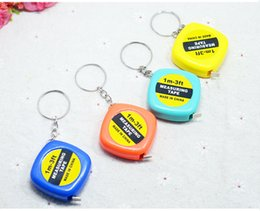 Wholesale Gift Measuring Tape - New 200pcs Small tape measure 1 meter portable mini soft tape measure ruler keychain pendant small gifts gift metric inch tape measure