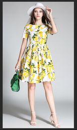 Fotos de vestidos redondos online-Vestido de las señoras de la manera libre, vestido de patrón de la impresión del limón del cuello redondo del algodón del color de la imagen europea y americana de la manera, recepción a sky2012