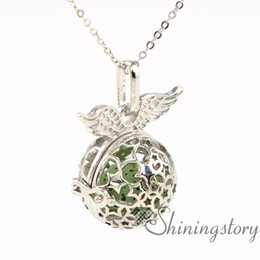 Wholesale Metal Charms Pendants Wings - wings aromatherapy pendants wholesale essential oil diffuser jewelry diffuser necklace diy glass bottle charm metal volcanic stone openwork