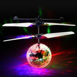 Wholesale Wholesale Light Up Balls - RC Helicopter Flying Induction LED Noctilucent Ball Quadcopter Drone Sensor Up grade Remote Control flying with lights Children Toys