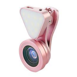 Neue marke heißer verkauf 3 in 1 objektiv füllen licht 04x 0,6x weitwinkel 15x makro objektiv universal selfie led licht für ios andorid handy von Fabrikanten