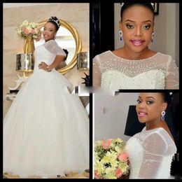 3d illusion perlen online-Luxus Plus Size Afrikanische Brautkleider Sheer Illusion Halbarm Kristall Perlen Perlen 2017 Meerjungfrau Hochzeit Brautkleider