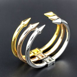 Wholesale Stainless Steel Taper Sets - Factory price foreign trade double pointed nail bracelet the American small giant riveted tapered steel bracelet