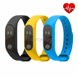 Misuratori di cuore online-Per Android IOS Smart Phone Il più nuovo M2 Smart Wristband del braccialetto 0.42 pollici Schermo OLED IP67 Supporto impermeabile Monitor della frequenza cardiaca Punto calibro