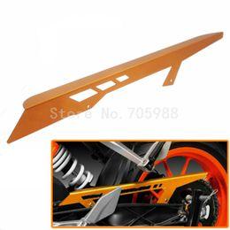 Nueva naranja Color Motorcycle CNC Cadena de aluminio cubierta de guardia para KTM DUKE 390 2013-2016 DUKE 125 2011-2016 DUKE 200 2012-2016 desde fabricantes