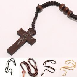 Al por mayor-Retro Estilo Hombres Mujeres Católica Cristo Rosario de madera del grano Cruz colgante Cuerda tejida Collar 8mm desde fabricantes