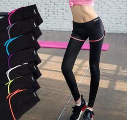 Argentina Pantalones de yoga falsos de dos piezas Leggings para mujeres Diseño de empalme de malla running fitness gym sports Ropa de ejercicio Yoga Outfits Sportswear Suministro
