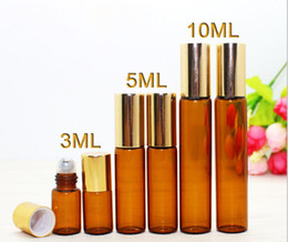 Wholesale Carton Oil - 3ml 5ml 10ml Empty Thick Amber Essential Oil Bottles 600pcs Carton With Stianless Steel Metal Ball Roller Gold Black Lids for Aromatherapy