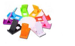 2019 soporte de teléfono celular de plástico Nuevo soporte portátil de plástico mini para teléfono móvil Soporte plegable ajustable para teléfono Soporte para iphone Samsung ipad Universal soporte de teléfono celular de plástico baratos