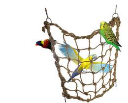 2019 loros de plastico Jaula de pájaros loro juguetes cuerda de cáñamo loro gran red de escalada El pájaro loro juguetes cuerda de cáñamo neto 123 g