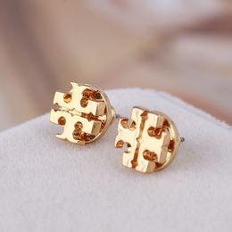 Wholesale Silver Gold Stud Earrings - Ne designn hot sale Brand name hollow round geometry Stud Earring in 1.0cm women wedding gift jewelery Free Shipping PS6635