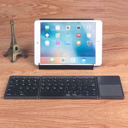 Wholesale Ipad Keypads - A18 Pocket Twice Folding Mini Keyboard Metal Bluetooth Foldable Wireless Keypad with Touchpad for iphone,Tablet,ipad,PC