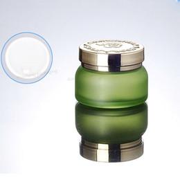 Canada 50G FROST VERT VERRE CRÈME COSMETIQUE JAR GOLD LID COUVERTURE - NOUVEAU 200PCS / LOT cheap cosmetic green glass jars wholesale Offre
