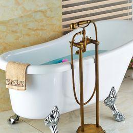 Banheira montada no chão on-line-Antique Brass Banheiro Piso Montado Torneira Da Banheira de Mão Chuveiro Estilo Telefone Banheira Enchimento Torneira Misturadora