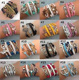Wholesale Antique Silver Infinity Bracelet - 55 Styles Infinity Charm Bracelets Multilayer Woven Leather Bracelets Antique Cross Anchor Love Peach Knitting Bronze Diy Charm Bangles