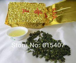 Cravatte cinesi online-2019 nuovo anno 250g tè cinese di Anxi Tieguanyin di grado superiore, Oolong, tè di Tie Guan Yin, tè di sanità, sottovuoto, trasporto libero, consiglia