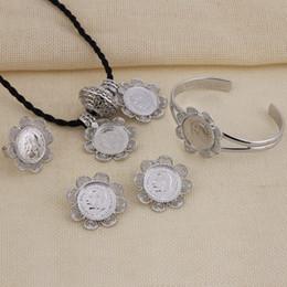 Argentina Nuevo Conjunto de joyas etíopes Moneda de cabeza de plata Colgante de cadena / Pendiente / Anillo / Brazalete Conjunto de boda nupcial Habesha africano cheap bridal silver jewelry chain set Suministro