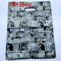 Wholesale clothes plastic packaging - Wholesale- 100pcs lot English Newspaper Design Plastic Gift Bag 20*15cm Clothes Jewelry Packaging Bag Big Plastic Shopping Bags 152021