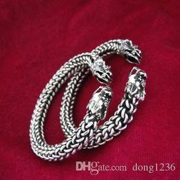 Wholesale Types Male Shoes - Ethnic wind Miao silver handmade Miao silver bracelet male and female models twisted head bracelet