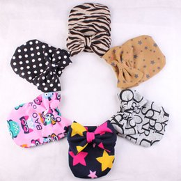 Wholesale Knitted Leopard Hats - Christmas Newborn Baby Knit Hats Letter Stripe Leopard Bow Dot Beanies Infant Baby Floral Caps Winter Hats