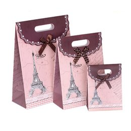 Wholesale Holiday Gift Paper Bag - packed paper bags Bow hand bag and retro Blue pink red coffee gift bags printing hand handle gifts Wrap for holiday party