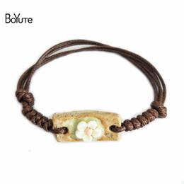 Wholesale Ceramic Carved - BoYuTe 5Pcs Bohemia Bracelet Women Vintage Flower Carved Ceramic Beads Braided Rope Bracelet Adjustable Women's Accessories